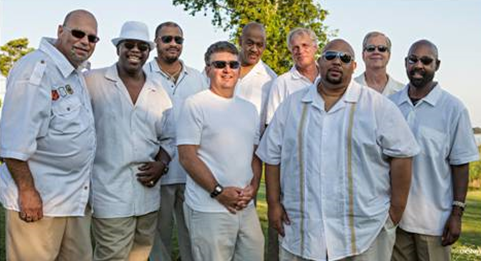 Slapnation (formerly the original Slapwater Band) will be performing in Merchants Square on July 31